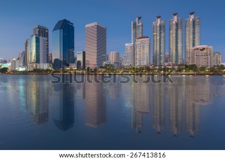 Twilight time at Bangkok city downtown with reflection of skyline, Bangkok,Thailand - stock photo