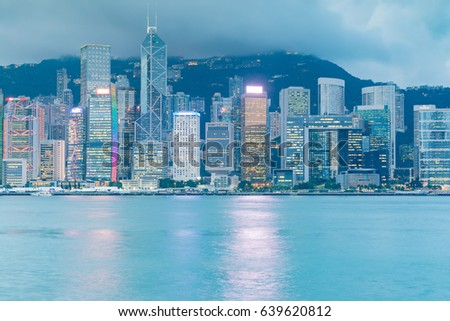 Twilight tone Hong Kong cityscape downtown business building background