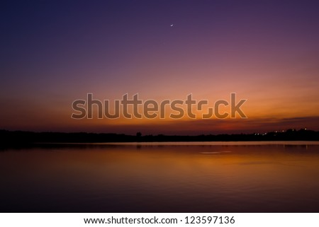 twilight with moon reflect water - stock photo