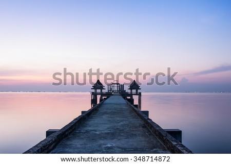 Twilight wood bridge at Djittabhawan Temple tourist attraction in Pattaya,Thailand - stock photo