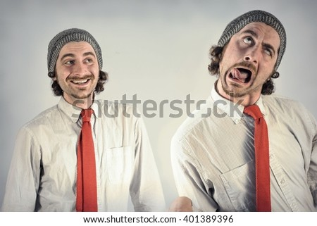 Twin adult men with beards making silly facial expressions - stock photo