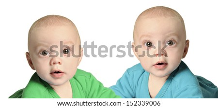 Twin baby boys in blue and green - stock photo