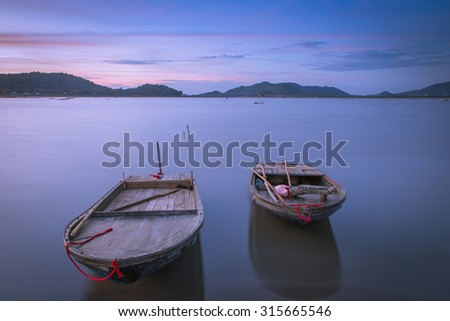 Twin boat at lake in Twilight after sunset , Thailand - stock photo