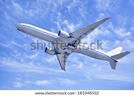 Twin-engine jet-liner climbing upwards after take-off.  - stock photo