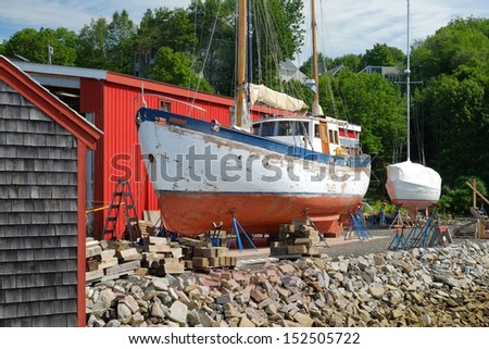 Twin masted trawler being repaired in a local boat yard  - stock photo