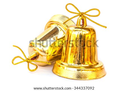 Twin old golden bells for Christmas new year decoration, isolated over white - stock photo