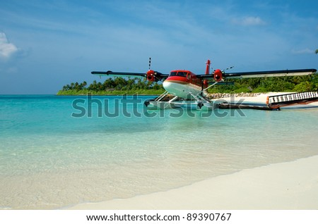 Twin Otter at a dock - stock photo