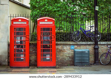 Twin red British telephone boxes and bikes in the background