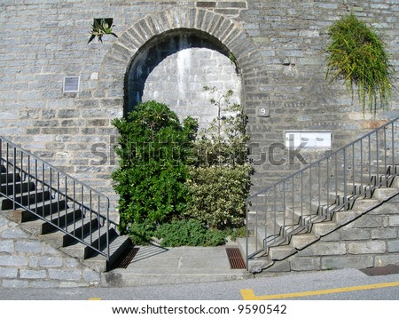 Twin stairs and arched stonewall in the city of Lugano, Switzerland - stock photo