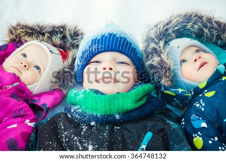 Twins and brother at snow