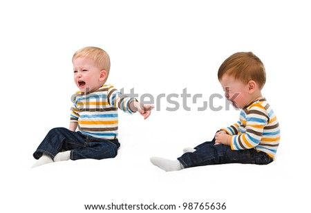 Twins. Both cry, offended each other, sibling, on the white - stock photo