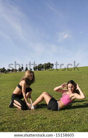 twins doing sports in the park - stock photo