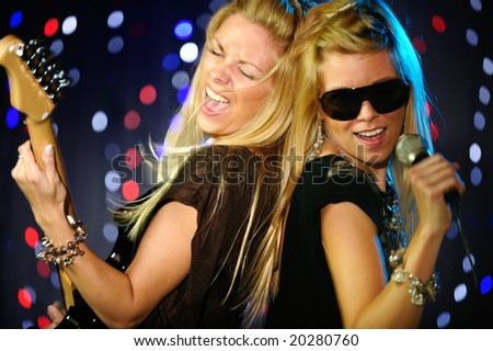 Twins girls performing on stage - stock photo