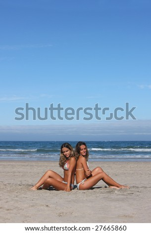 twins having fun in the beach - stock photo
