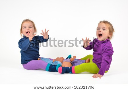 Twins laughing and waving - stock photo