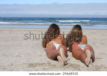 twins looking the sea in the beach - stock photo