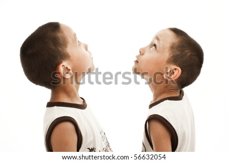 twins looking up isolated on white - stock photo