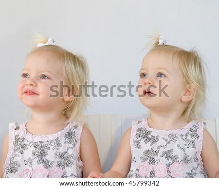 Twins Smiling Having Fun Playing - stock photo