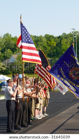 TWINSBURG, OH - June 5: A color guard stands at attention at the beginning of Relay for Life, an annual fundraising event sponsored by the American Cancer Society, June 5, 2009, in Twinsburg, Ohio. - stock photo
