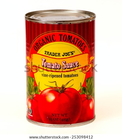 TWINSBURG, OH, USA - FEBRUARY 7, 2015: A can of Trader Joe's Organic Tomato Sauce. Trader Joe's is headquartered in Monrovia, California, and has stores in over 39 states. - stock photo