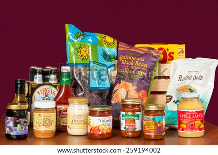 TWINSBURG, OH, USA - JANUARY 17, 2015: An assortment of grocery products with the Trader Joe's brand name (with two exceptions). Trader Joe's is headquartered in Monrovia, California. - stock photo