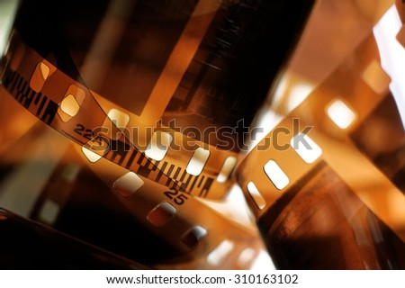Twisted film from the camera - stock photo