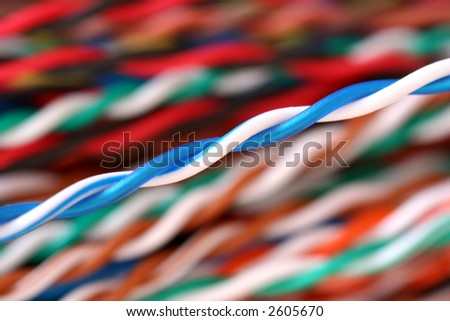 Twisted pair telephone cable with one unique pair standing out - stock photo