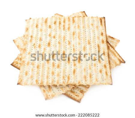 Twisted pile of multiple machine made matza flatbreads, composition isolated over the white background