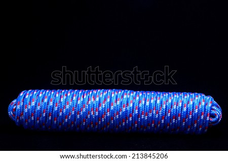 Twisted Roll of Rope On a Black Background - stock photo