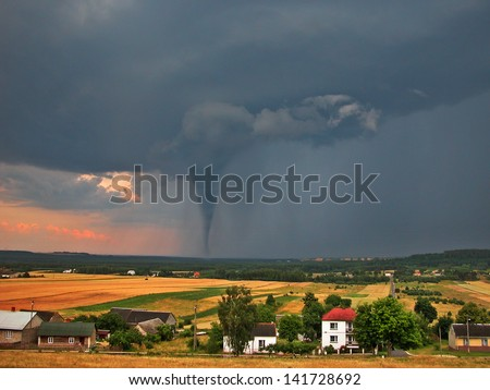 Twister on countryside - stock photo