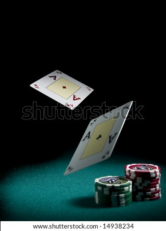 Two aces flying over a green felt with three piles of different colors chips.