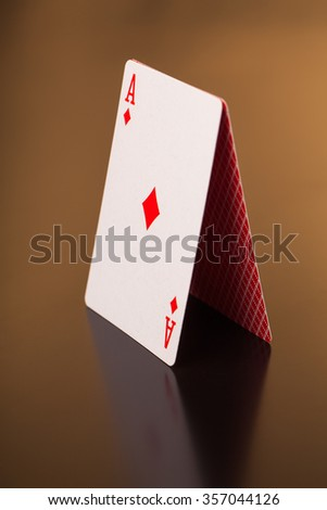 two aces of playing cards  on reflective table
