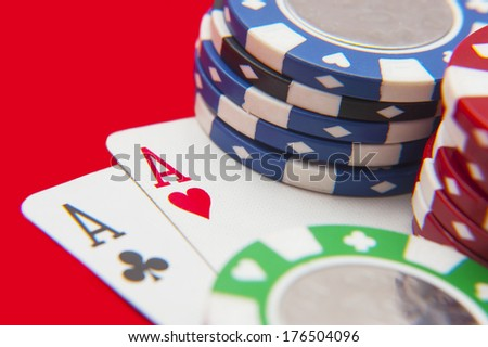 Two aces poker hand with stack of poker chips  - stock photo