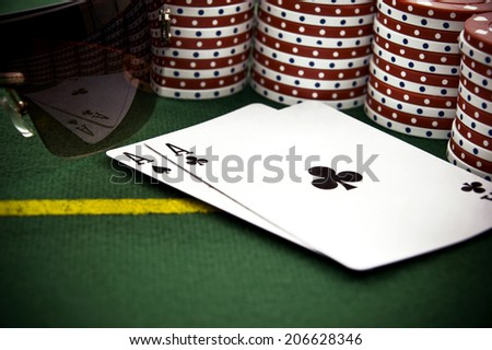 Two Aces with Poker Chips in Front and Reflection on the Glasses - stock photo