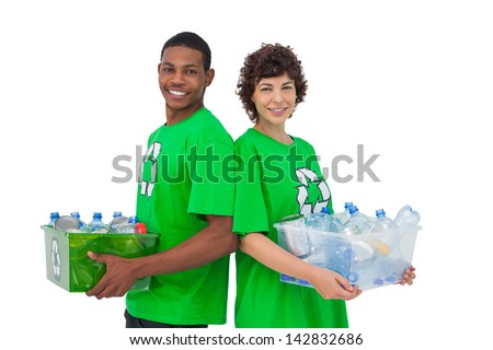 Two activists holding box of recyclables and standing back to back on white background