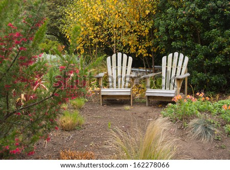 Two adirondack chairs - stock photo