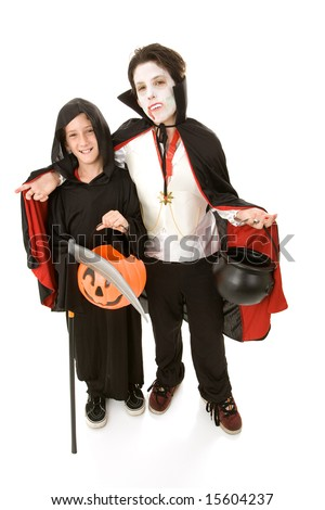 Two adorable boys in their halloween costumes.  Full body isolated on white. - stock photo