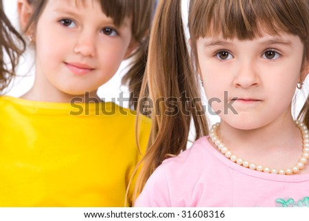 Two adorable little girls on white background - stock photo