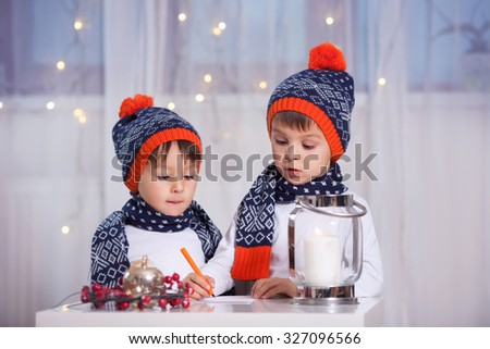 Two adorable little preschooler children, boy brothers, writing letter to Santa - stock photo