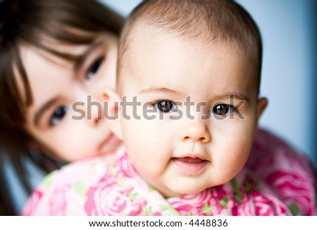 two adorable sisters - stock photo