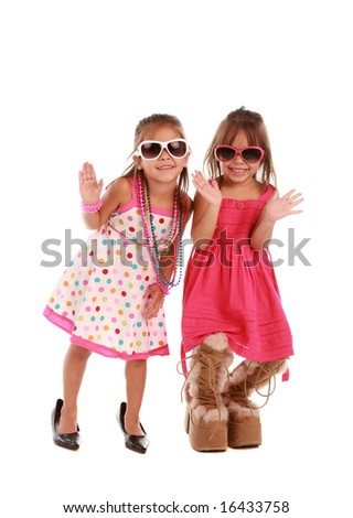 Two adorable sisters on pure white background - stock photo