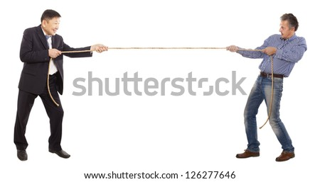 Two adult businessman pull the rope