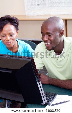 two adult students studying computer together - stock photo
