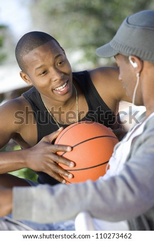 Two African American young men talking - stock photo