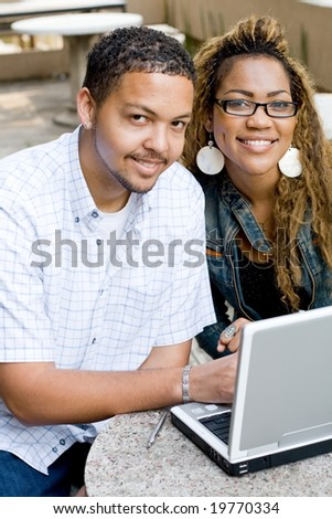 two african college students study computer together
