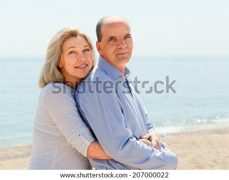 Two aged  lovers spending time together in bathing-place
