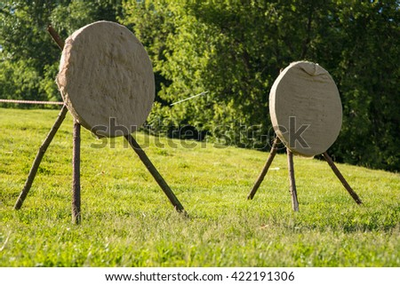 two aims in the field. arrows hit target, successful concept. - stock photo