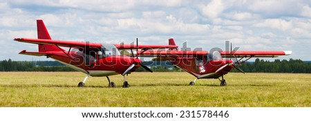 two airplane on the ground - stock photo