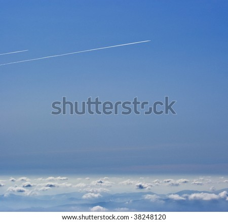 Two airplanes flying above clouds - stock photo