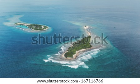 Two amazing tropical islands located in area of North Atoll in Maldives. Picture taken from air - stock photo
